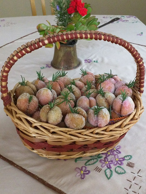 A basket with pastries in the form of little peaches